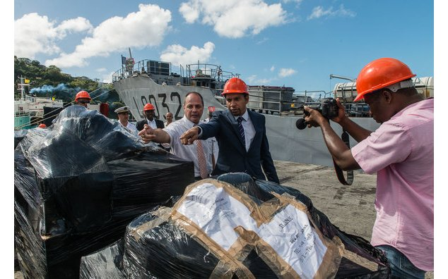 The Minister of Foreign Affairs, Mr. Camillo GONSALVES and Jean-Luc MURE, Cultural Advisor and Regional Cooperation inspecting the cargo